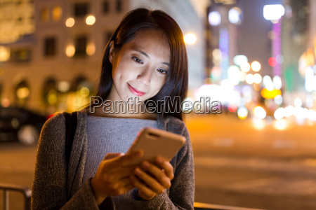 woman using on cellphone in hong