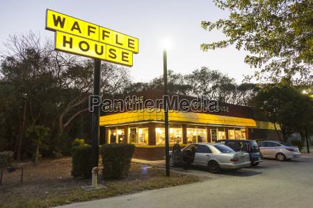 waffle house restaurant illuminated at dusk