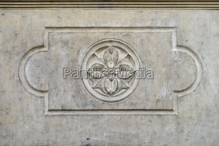 stone relief with rose motif