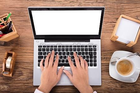 businesswoman using laptop on desk