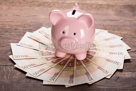 piggybank on euro note