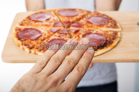 person rejecting to eat pizza