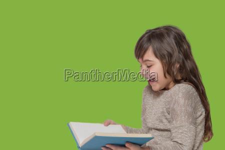smiling little girl holding open book