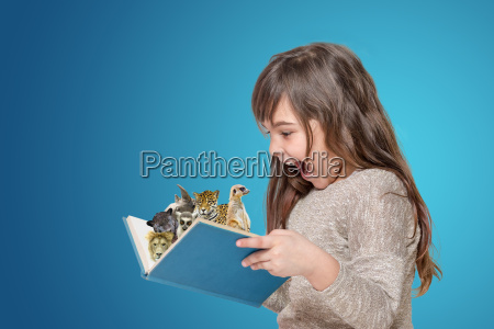 surprised little girl holding open book