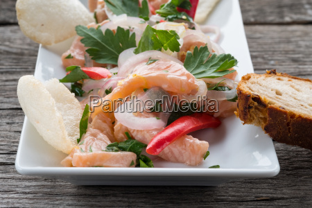 snack ceviche with salmon onions and