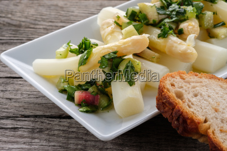 white asparagus as salad with herbs
