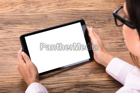 businesswoman holding digital tablet in hand
