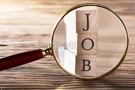 job block seen through magnifying glass