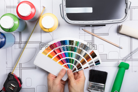 an architect choosing color from swatch