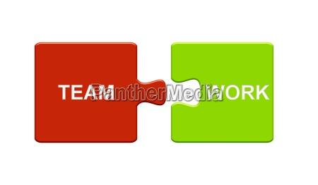 puzzle stuecke zeigen teamwork