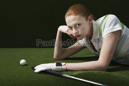 woman lying on course with golf