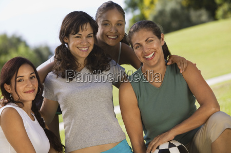 female friends with soccer ball at