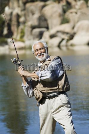 senior man fishing on a sunny