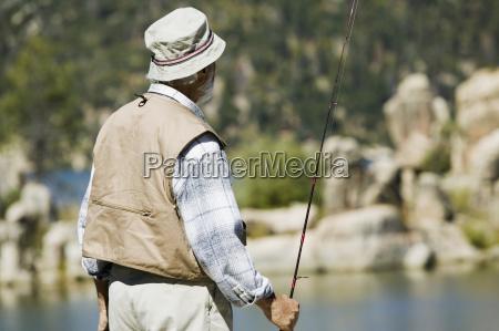 senior man holding fishing rod