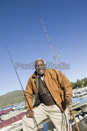 man with fishing rods