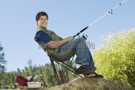 smiling man with fishing rod