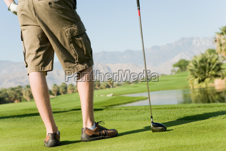 young man with golf club