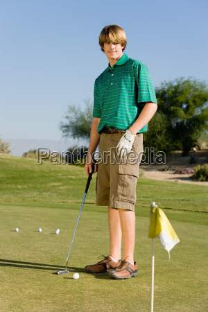 young male golfer playing golf