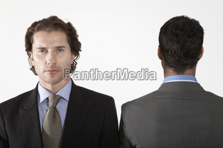 portrait of businessman with colleague facing