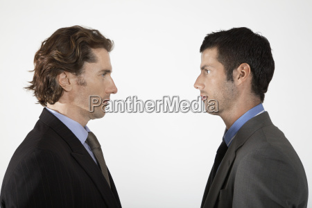 businessmen face to face on white