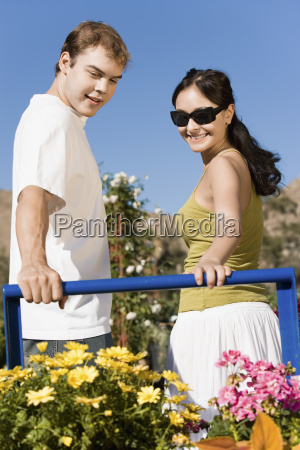 happy couple with flower plants