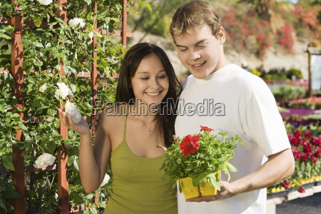happy couple with potted plants