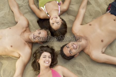happy group of friends lying on