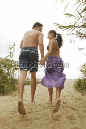 couple running at beach