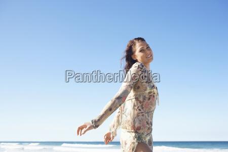 beautiful teenage girl posing on beach