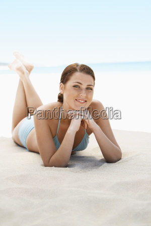 beautiful teenage girl smiling while lying