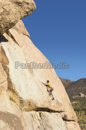 side view of a man climbing