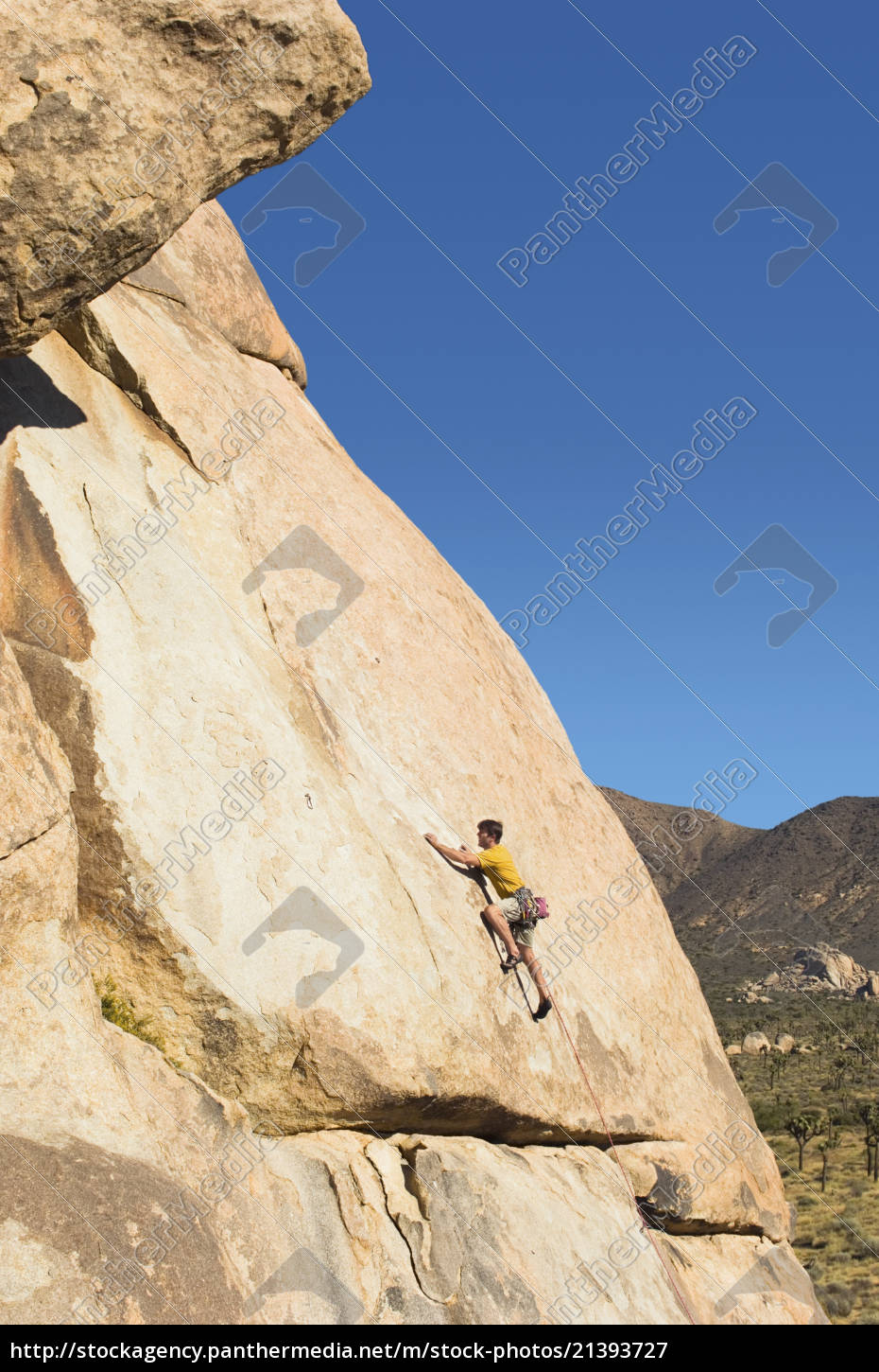 side, view, of, a, man, climbing - 21393727