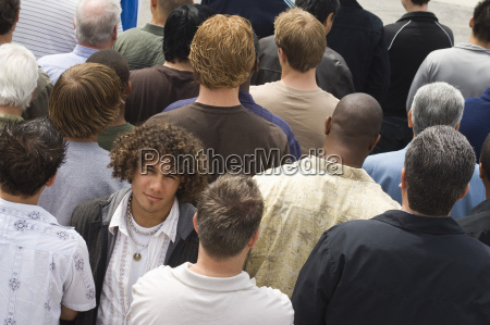 young man surrounded by multiethnic people