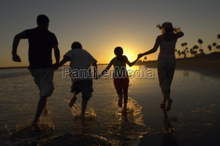 family enjoying on beach