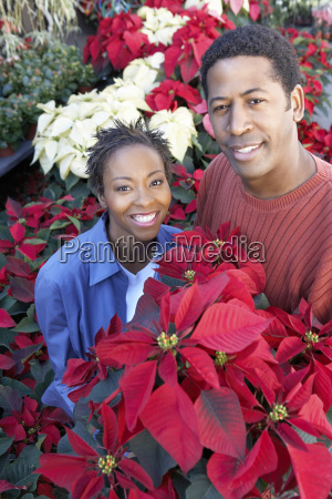 african american couple buying flowers