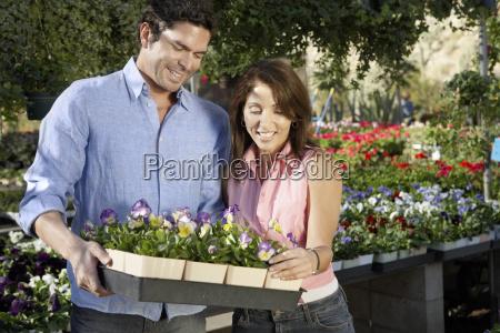 couple buying flower plants