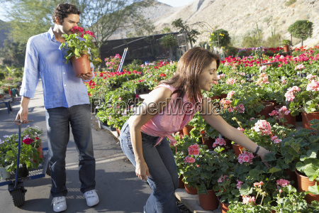 couple selecting flower plants