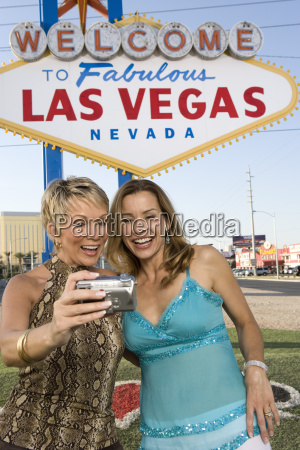 female friends taking self portrait with