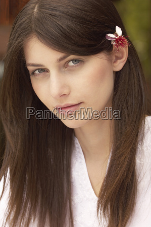 beautiful young woman with flower in