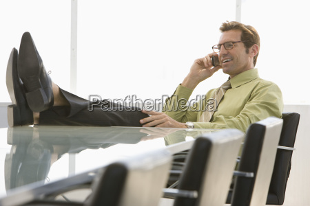 businessman using cell phone in conference