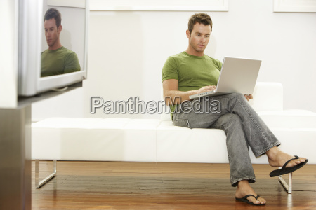 young man using laptop in modern