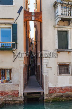 narrow street in venice city in
