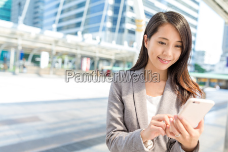business woman using cellphone in bangkok