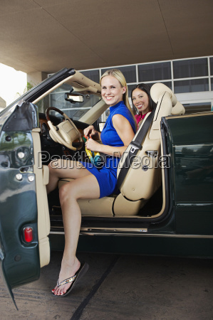 cheerful female friends in convertible