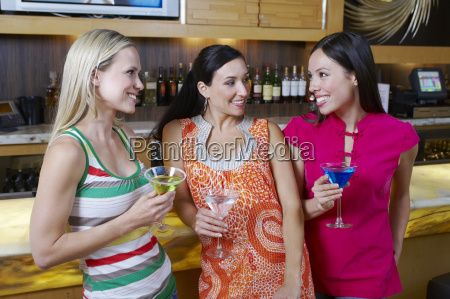 female friends with drinks at bar