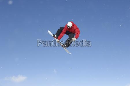snowboard free rider making high jump