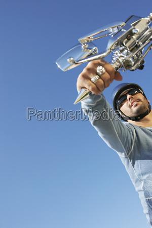 man holding bike accelerator