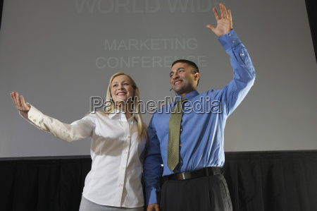 man and woman at business convention