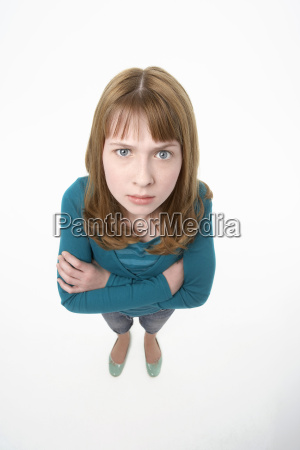 angry teenage girl with hands folded