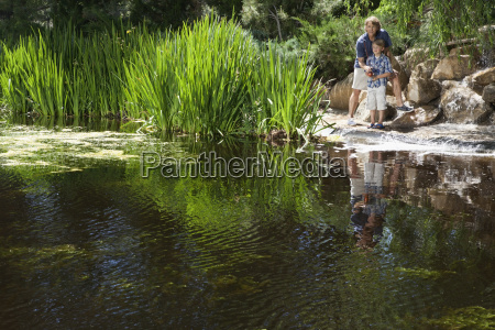 man and son fishing together by